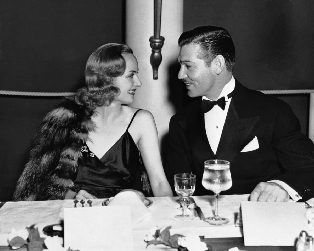 Carole Lombard and Clark Gable at a New Years Eve Party, 1939.