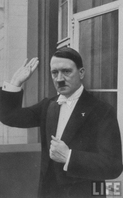 Hitler says goodbye at a New Year's banquet. Berlin, 1936