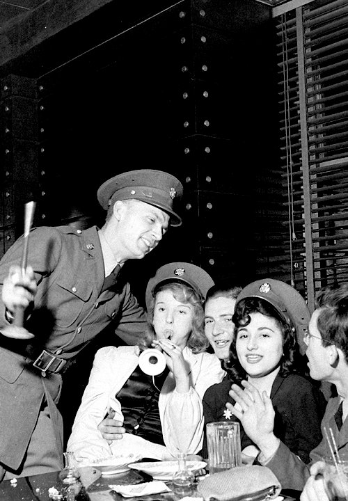 Partiers in New York City on New Year's Eve, as 1941 turns to 1942.