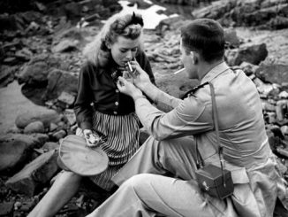 A US Navy flier and his date smoking on the coast of Morocco. Casablanca, 1943