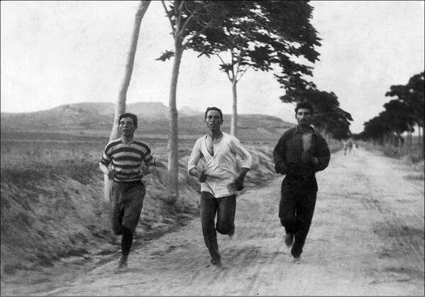 Three men running in the first marathon at the 1896 Summer Olympics